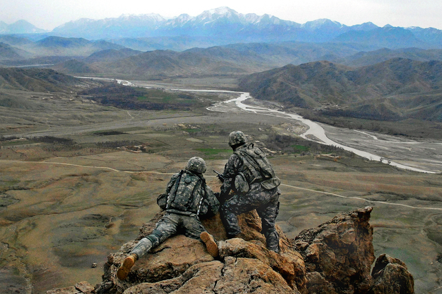 U.S. Army 1LT Jared Tomberlin (left) from Bravo Company, 1st Battalion, 4th Infantry Regiment gets a first hand view of the land with outgoing commander 1LT Larry Baca from Charlie Co. 1-4, on top of a ridge near Forward Operation Base Lane, Zabul Province, Afghanistan, on February 21, 2009. (U.S. Army photo by Staff Sergeant Adam Mancini / Released)